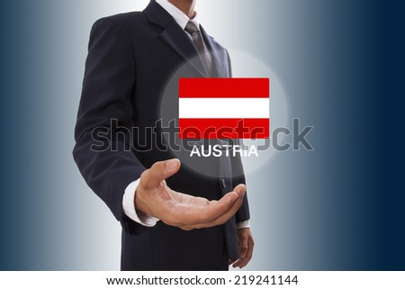 Businessman hand showing Austria Flag