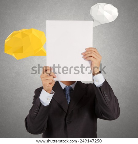 businessman hand showing blank book with low poly geometric speech bubble  - stock photo