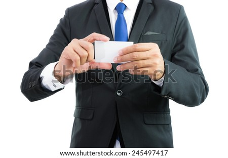 Businessman hand showing business card or note paper isolate on over white background