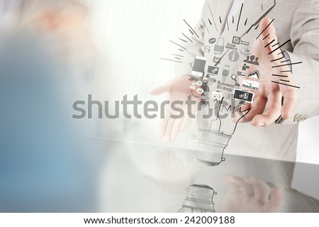 businessman hand showing creative business strategy with light bulb as concept  - stock photo