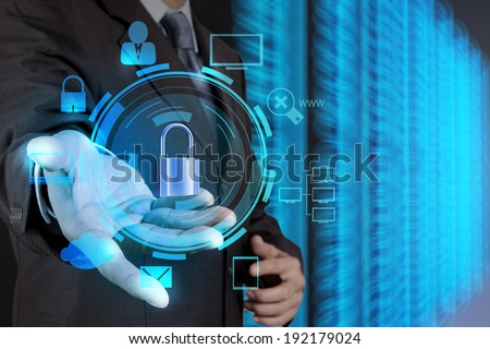businessman hand showing 3d padlock on touch screen computer as Internet security online business concept  - stock photo