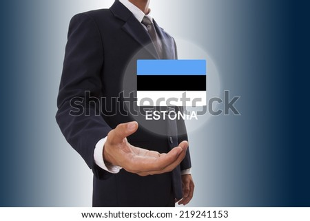 Businessman hand showing Estonia Flag