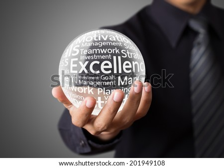 Businessman hand showing excellence word in crystal ball - stock photo