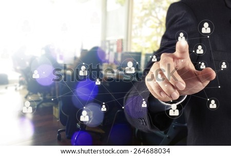 businessman hand showing human icon flow chart on new modern computer as concept with bokeh exposure - stock photo