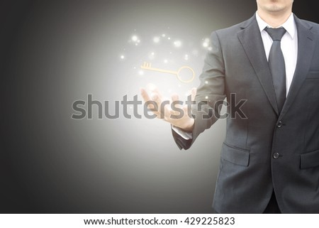 Businessman hand showing key to success , success business concept