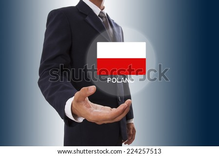 Businessman hand showing Poland Flag