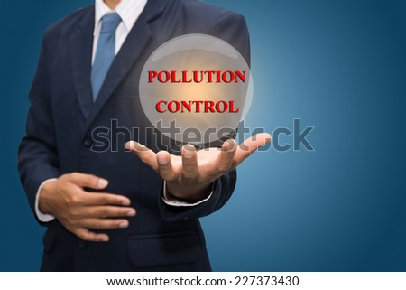 Businessman Hand Showing POLLUTION CONTROL - stock photo