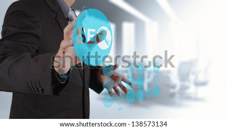 businessman hand showing search engine optimization SEO as concept - stock photo