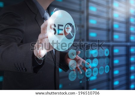 businessman hand showing search engine optimization SEO icon as concept