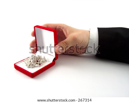 businessman hand showing some jewelry - stock photo