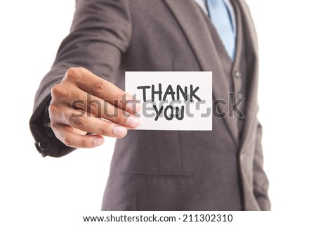 "Businessman hand showing someone his business card with""thank you"" message - stock photo"