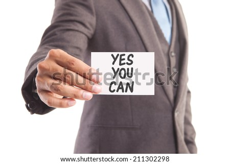 "Businessman hand showing someone his business card with""yes you can"" message - stock photo"