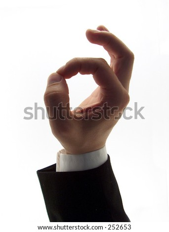 businessman hand showing the ok sign - stock photo