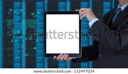 businessman hand shows blank tablet computer and server room background as concept - stock photo