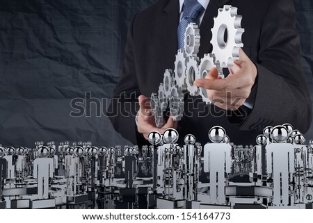 businessman hand shows gear to success concept with crumpled recycle paper background as concept