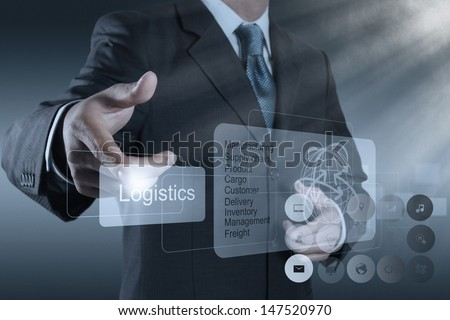 businessman hand shows logistics diagram as concept - stock photo