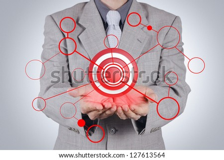 businessman hand shows target symbol as concept - stock photo
