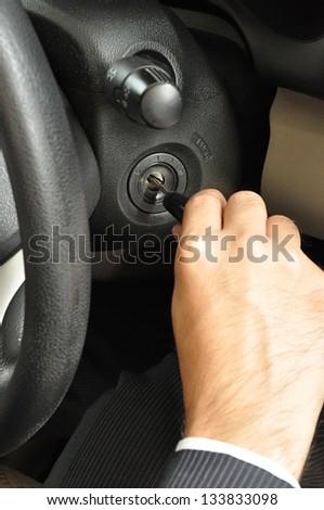 Businessman hand starting the car - stock photo