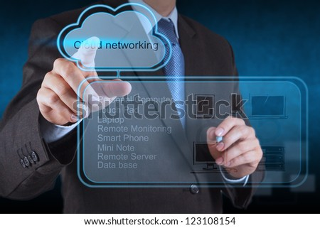 Businessman hand touch a Cloud Computing diagram on the new computer interface - stock photo