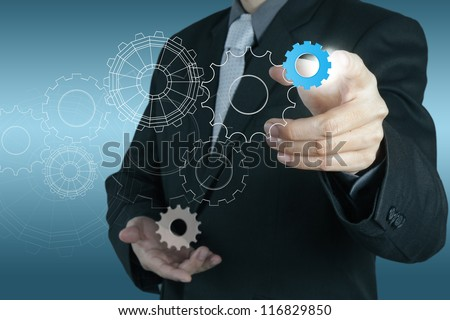 businessman hand touch blue  gear to success concept - stock photo
