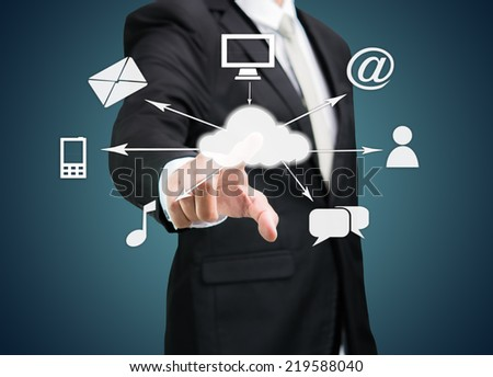 Businessman hand touch cloud computing concept on drak background - stock photo