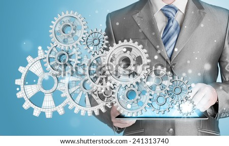 businessman hand touch gear to success as concept - stock photo