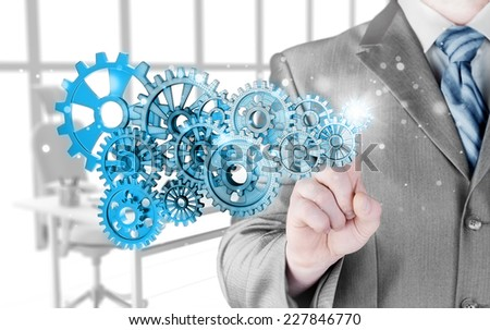 businessman hand touch  gear to success concept - stock photo