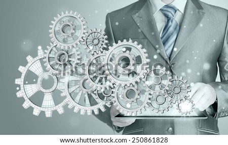 businessman hand touch  gear to success concept