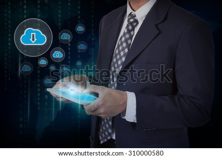 Businessman hand touch screen download from cloud icons on a tablet. - stock photo