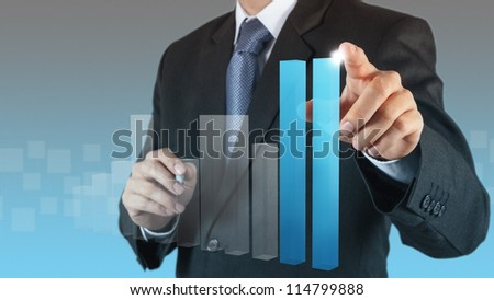 businessman hand touch virtual bar chart as concept - stock photo