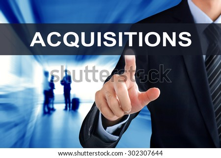 Businessman hand touching ACQUISITIONS sign on virtual screen - stock photo