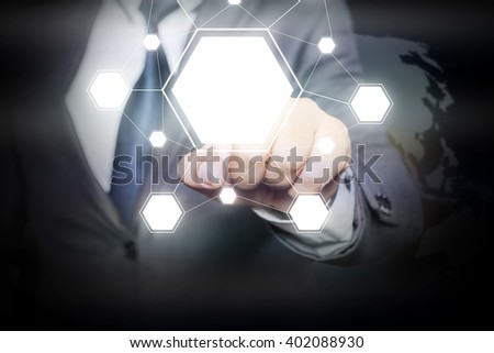 Businessman hand touching  blank icons on virtual screen with  icons linked as network - stock photo