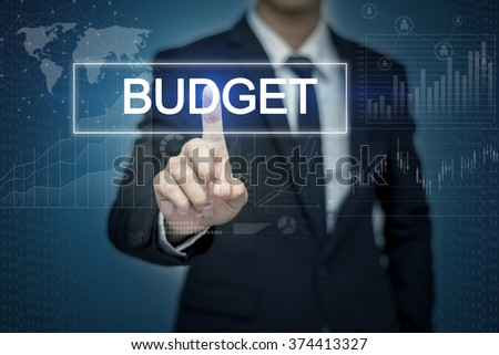 Businessman hand touching BUDGET button on virtual screen