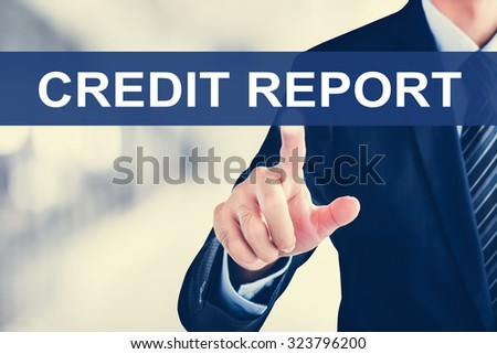 Businessman hand touching CREDIT REPORT sign on virtual screen - stock photo