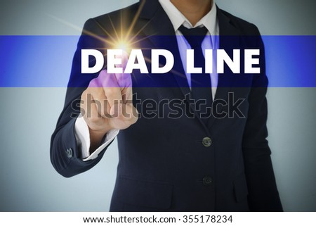 Businessman hand touching DEAD LINE