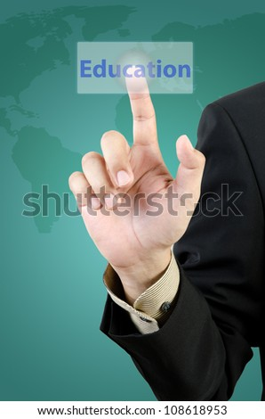 businessman hand touching education button