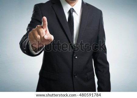 Businessman hand touching empty virtual screen, modern business background concept - can be used for montage your text or pictures at the finger