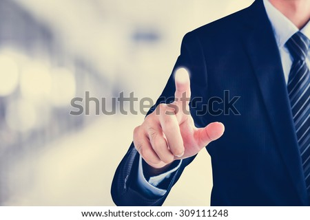 Businessman hand touching empty virtual screen, user interface (UI) background concept - can be used for montage your text or pictures at the finger - stock photo
