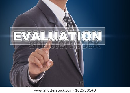 Businessman hand touching evaluation on screen  - stock photo