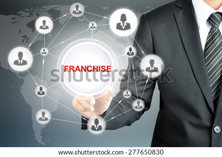 Businessman hand touching FRANCHISE sign with businesspeople icon network on virtual screen - stock photo