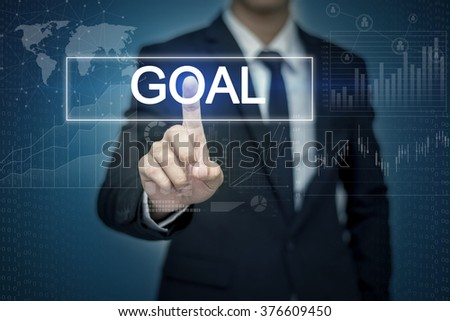 Businessman hand touching GOAL button on virtual screen