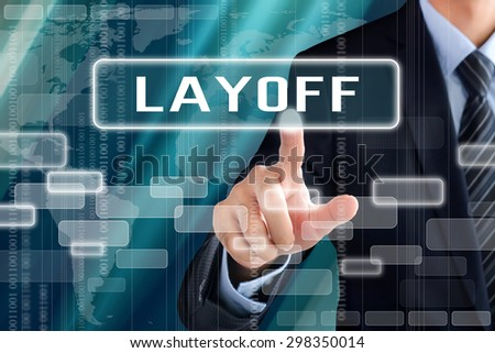 Businessman hand touching LAYOFF sign on virtual screen - stock photo