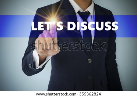 Businessman hand touching LET'S DISCUSS tab on virtual screen , business concept , business idea