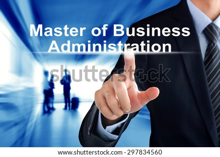 Businessman hand touching Master of Business Administration (or MBA) text on virtual screen - stock photo