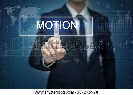 Businessman hand touching MOTION  button on virtual screen