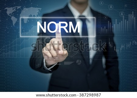 Businessman hand touching  NORM button on virtual screen