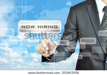 Businessman hand touching NOW HIRING sign on virtual screen - stock photo