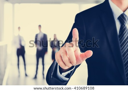 Businessman hand touching on empty virtual screen, modern business user interface (UI) background concept - stock photo