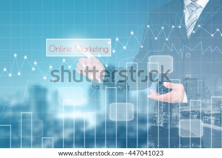 Businessman hand touching ONLINE MARKETING button on virtual screen with forex graph