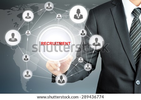 Businessman hand touching RECRUITMENT sign on virtual screen with people icons linked as network - stock photo